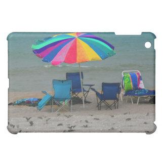 colorful beach umbrella chairs Florida scene iPad Mini Covers