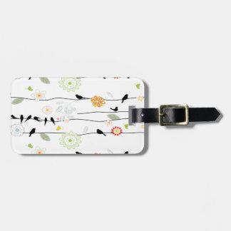 Colorful_birds en un alambre etiquetas para maletas