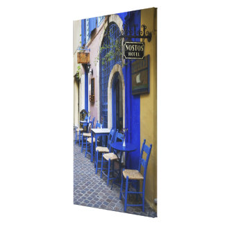 Colorful Blue doorway and siding to old hotel in Gallery Wrap Canvas