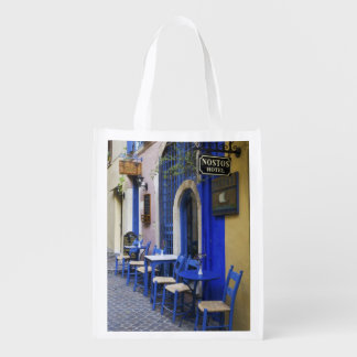 Colorful Blue doorway and siding to old hotel in Reusable Grocery Bags