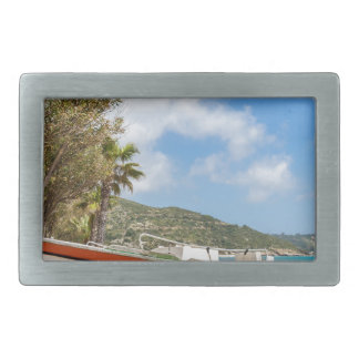 Colorful boat lying on greek beach rectangular belt buckle