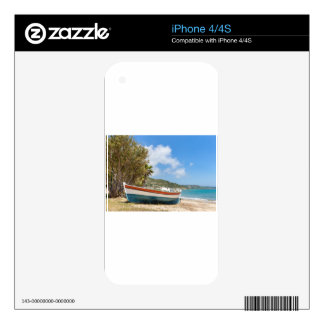 Colorful boat lying on greek beach skins for iPhone 4S