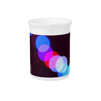 Colorful bokeh lights beverage pitcher