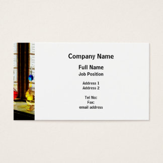 Colorful Bottles in Drug Store Window Business Card