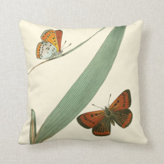 Colorful Butterflies Fluttering Around a Leaf Throw Pillow