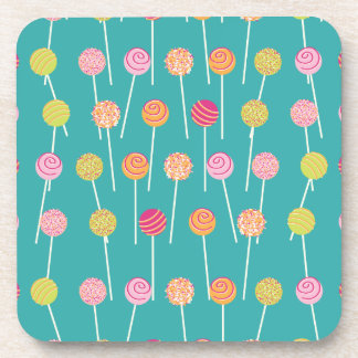 Colorful Cake Pops on Teal Pattern Coasters