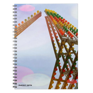 Colorful Carnival Sizzler Ride Lights and Skyline Notebook