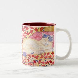 Colorful cat on sofa mug