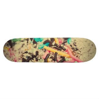 Colorful chocolate sprinkles macro skate board