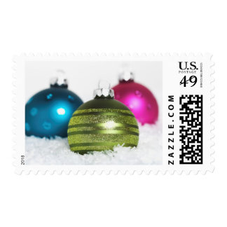 Colorful Christmas balls in the snow Postage
