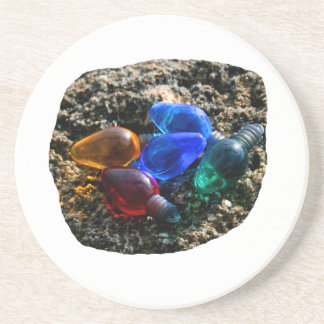 Colorful Christmas Bulbs in Beach Sand Photograph Beverage Coaster