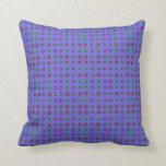 colorful circle pattern on purple pillow