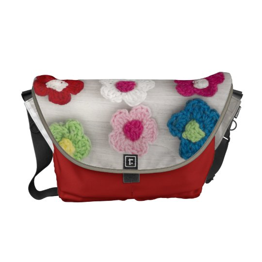 colorful crocheted flowers messenger bag