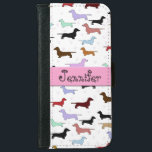 "Colorful Dachshund iPhone Wallet<br><div class=""desc"">Pretty cell phone wallet that is perfect for any dog lover.  It features a white background with colorful little dachshunds all over it.  You can customize the text in the pink stripe in the center.</div>"