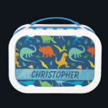 """Colorful Dinosaur Pattern to Personalize Lunch Box<br><div class=""""desc"""">Colorful Dinosaur silhouette pattern that you can personalize and add your own name. Tyrannosaurus Rex,   titanosaurs,  Triceratop,  raptors,  Ankylosaurs,  Dino-Birds,   Stegosaurus,   Apatosaurus,  Pteranodon and more in a colorful pattern in blue background,   and dinosaurs in green,  blue,  yellow and orange.</div>"""