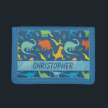 """Colorful Dinosaur Pattern to Personalize Tri-fold Wallet<br><div class=""""desc"""">Colorful Dinosaur silhouette pattern that you can personalize and add your own name. Tyrannosaurus Rex,   titanosaurs,  Triceratop,  raptors,  Ankylosaurs,  Dino-Birds,   Stegosaurus,   Apatosaurus,  Pteranodon and more in a colorful pattern in blue background,   and dinosaurs in green,  blue,  yellow and orange.</div>"""