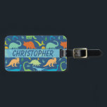 """Colorful Dinosaur Personalize Address Luggage Tag<br><div class=""""desc"""">Dinosaur silhouette pattern that you can personalize and add your own name. Tyrannosaurus Rex, titanosaurs, Triceratop, raptors, Ankylosaurs, Dino-Birds, Stegosaurus, Apatosaurus, Pteranodon and more in a colorful pattern in blue background, and dinosaurs in green, blue, yellow and orange. The back is ready to personalize and add a name, address and...</div>"""