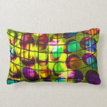 Colorful dots behind grid pillows