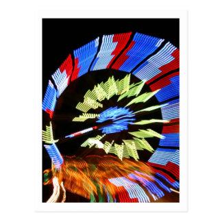 Colorful fair ride design, neon colors on black #1 postcard