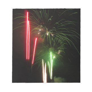 Colorful fireworks of various colors light up the memo pads