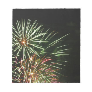 Colorful fireworks of various colors light up the notepads