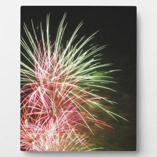 Colorful fireworks of various colors plaque