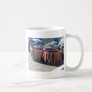 Colorful fishing nets in the harbor . Tuscany Coffee Mug