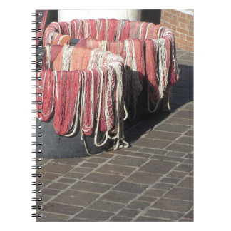 Colorful fishing nets in the harbor Tuscany, Italy Notebook