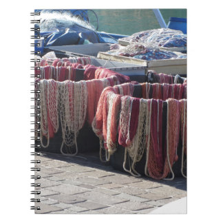 Colorful fishing nets in the harbor . Tuscany Notebook