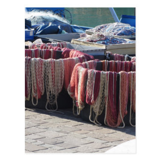 Colorful fishing nets in the harbor . Tuscany Postcard