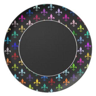 Colorful fleur de lis pattern on black party plates