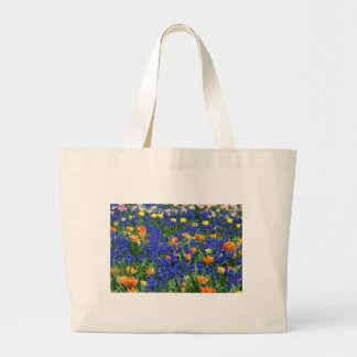Colorful flowers, blue and orange canvas bags