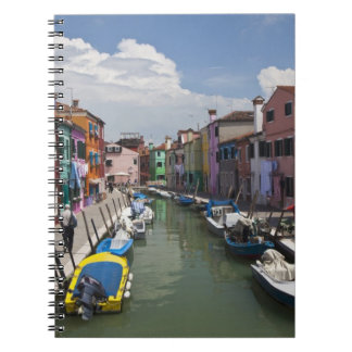 Colorful homes along canal on the island of spiral notebook