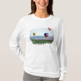 Colorful hot air balloons float over wheat T-Shirt