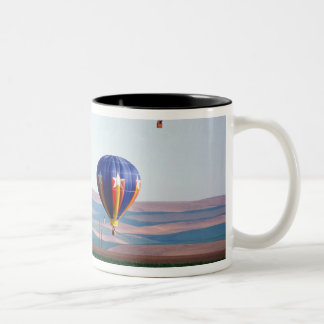 Colorful hot air balloons float over wheat Two-Tone coffee mug