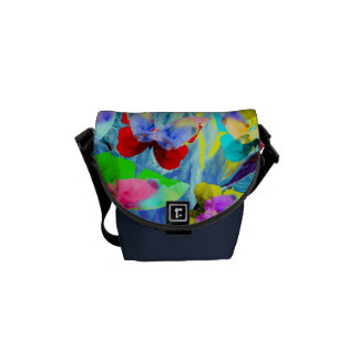 Colorful illustration of butterflies on blue plant messenger bag