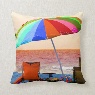 Colorful invert beach umbrella and chairs on Flori Throw Pillow
