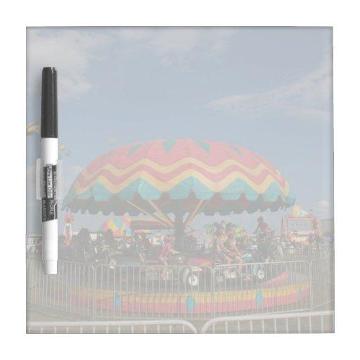 Colorful kid ride at fair dry erase board