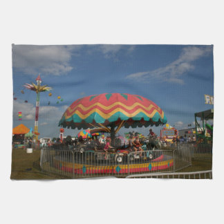 Colorful kid ride at fair hand towels