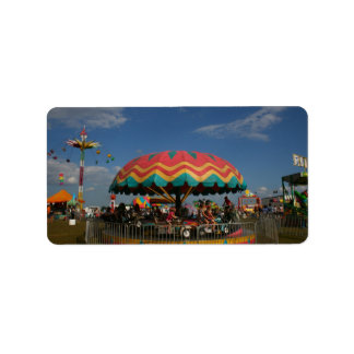 Colorful kid ride at fair address label