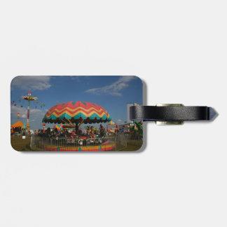 Colorful kid ride at fair bag tags