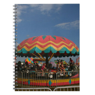 Colorful kid ride at fair notebook