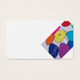 colorful kites flying  in single file in the sky business card