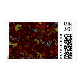 Colorful leaves and flowers against camouflage postage