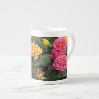 Colorful miniature roses tea cup