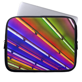 Colorful neon tubes at shop entrance laptop sleeve