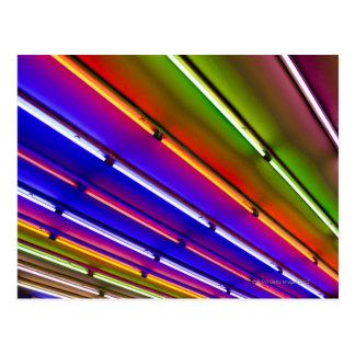 Colorful neon tubes at shop entrance postcard