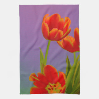 Colorful orange tulips on purple kitchen towel