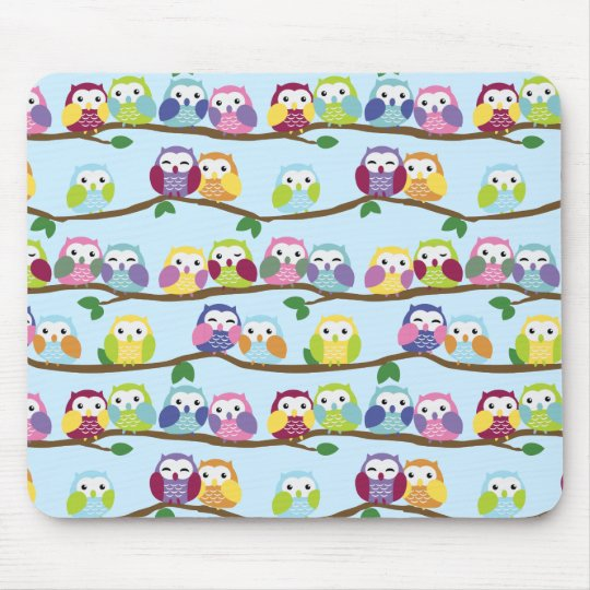 Colorful owls on a branch mouse pad