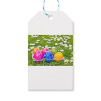 Colorful painted easter eggs in grass with daisies gift tags